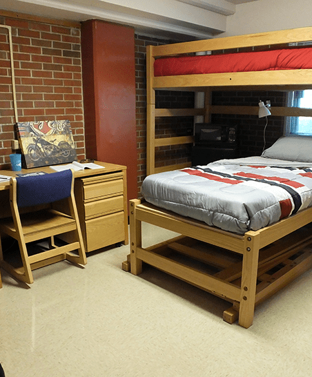 Beds configured as one lofted and one below. Room includes one detached desk/chair plus one built-in (see next photo).