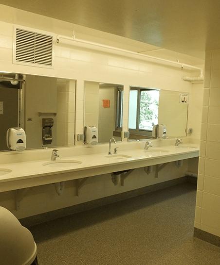 Community bathroom view of sinks
